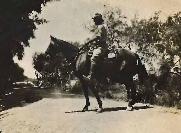 Guy riding and holding Midnight.jpg