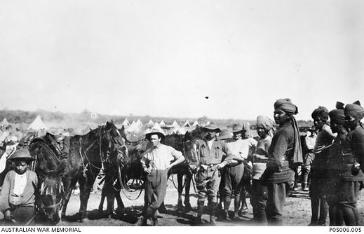Handing over horses to Indian cavalry -