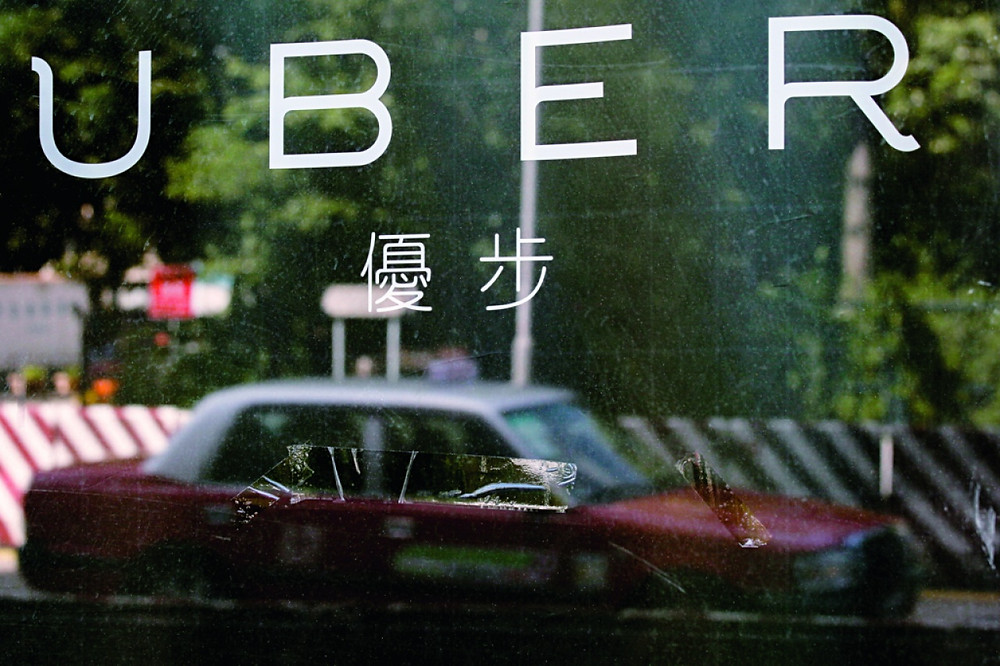 Uber在世界各地都有就其合法性問題打官司。(資料圖片)