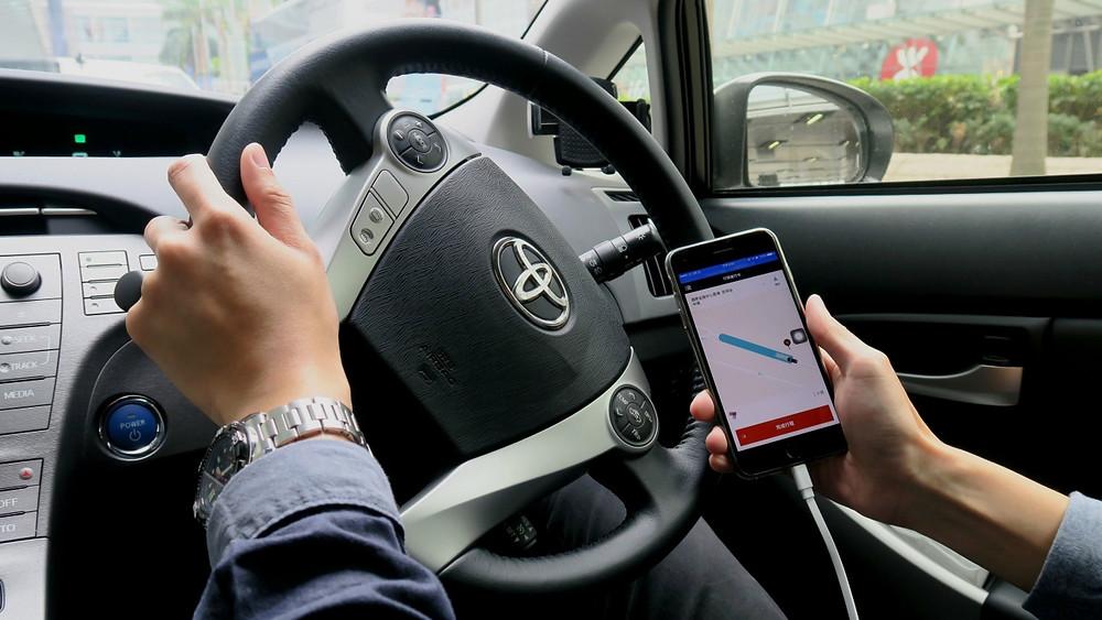 有Uber司機表示,如Uber被裁定非法經營,就不會再上線。(甄挺良攝)