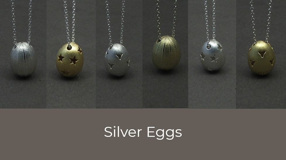 Silver eggs necklaces.jpg