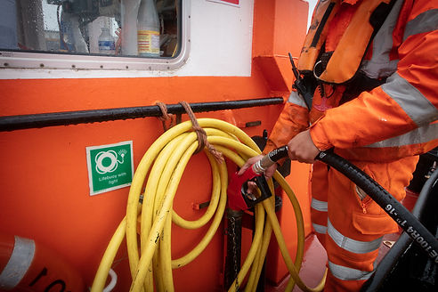 Photograph by Barry Cawston, fuelling a Thames barge