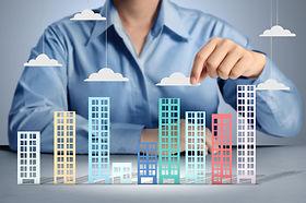 Building in a hand businessmen.jpg