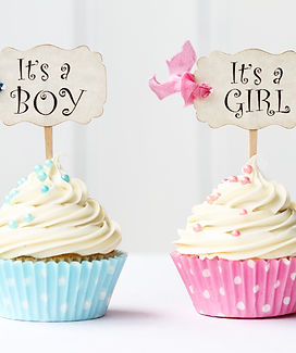 Baby shower cupcakes for a girl and boy.
