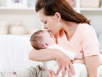 mother-kissing-her-sleeping-baby_edited.jpg