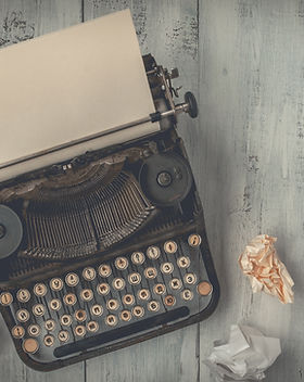 Typewriter with crumled papers