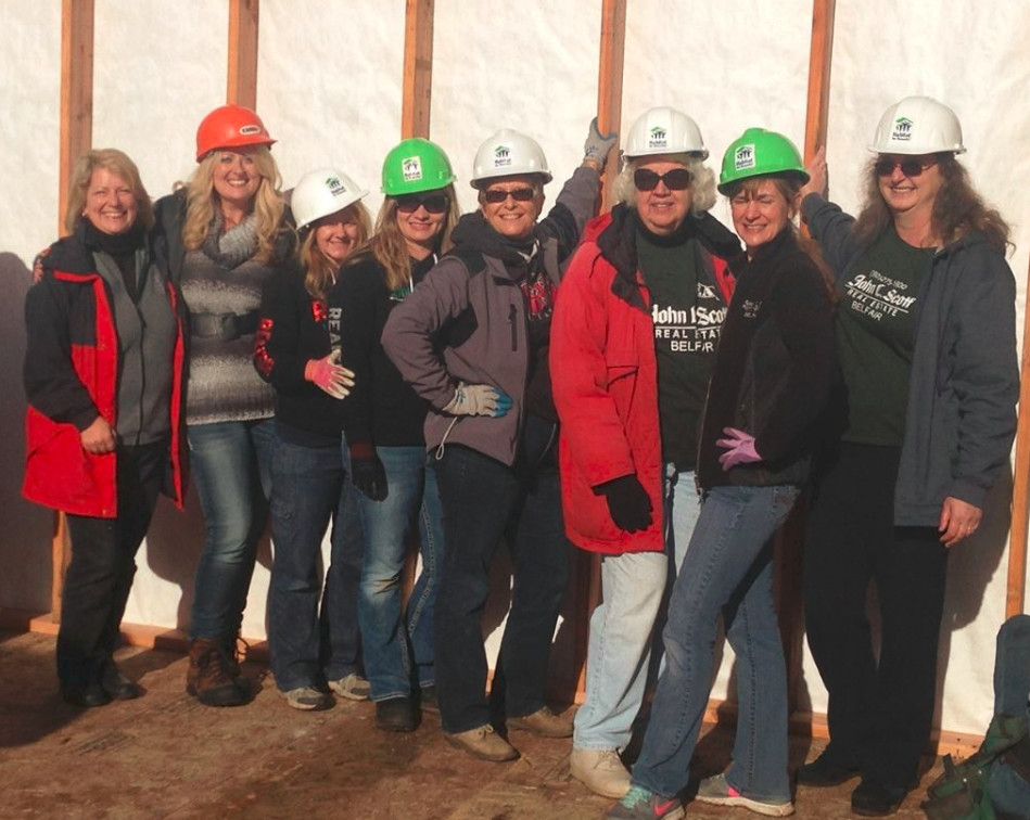 Local realtors join Habitat in raising a wall
