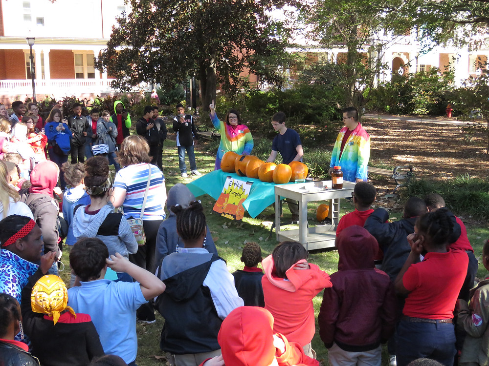 Dr. Lisse and her college students conducting an experiment to blow up pumpkins for our students.
