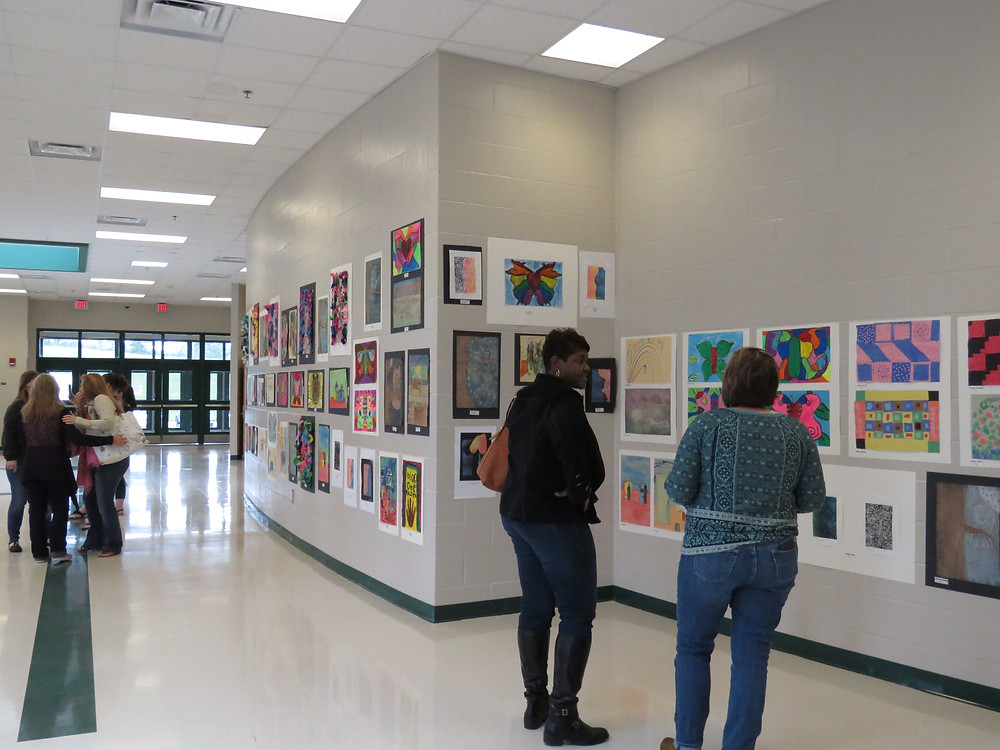 Community members checking out last years Fine Arts showcase exhibits.