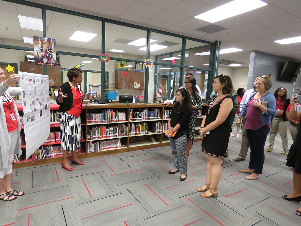 Superintendent Dr. Noris Price leading the Young Gamechangers on a tour of the BHS media center currently under renovation.