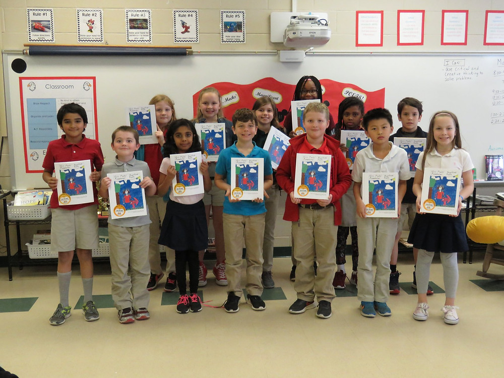 Students in Mrs. Meeks' class posing with their newly published work.