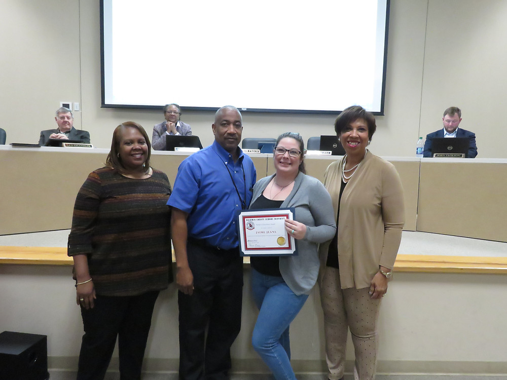 Ms. Jeanes receiving her pursuit of excellence award.