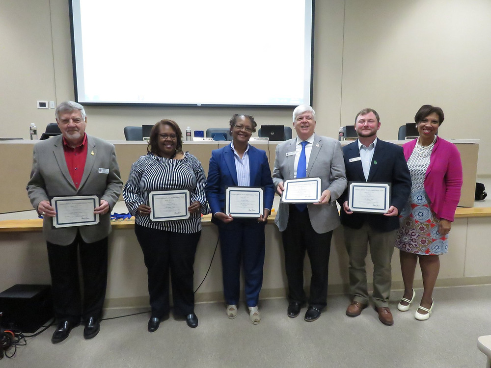 Board members receiving their recognition.