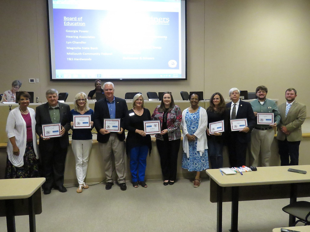 Several Partners In Education pose with Dr. Price and Chairman Jackson during board recognitions.