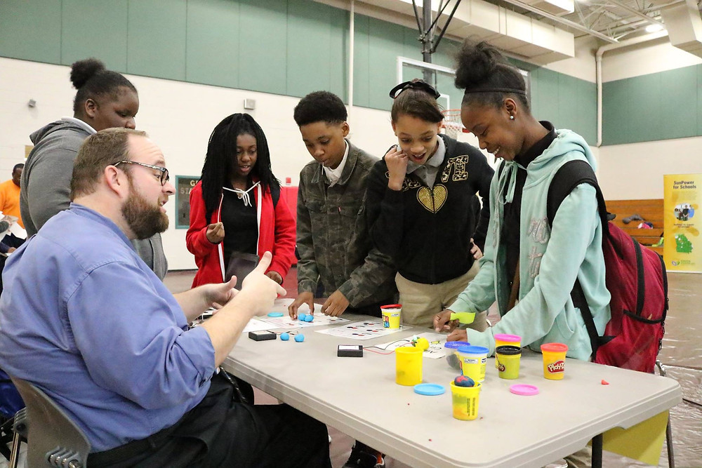 Oak Hill students participating in a challenge during STEAM night.