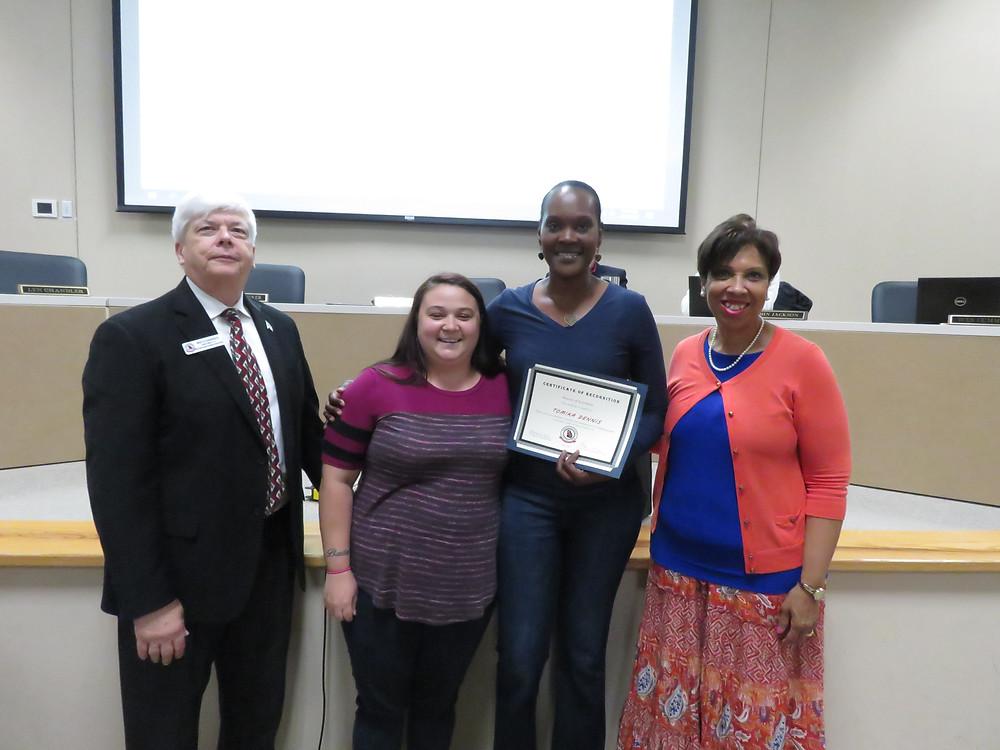 Tomika Dennis receiving her award.