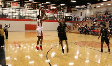 BHS player taking a 3 point shot over defender