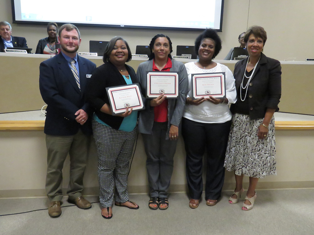 Kachari Davis, Constance Tucker and Kori Rucker being recognized at our board meeting.