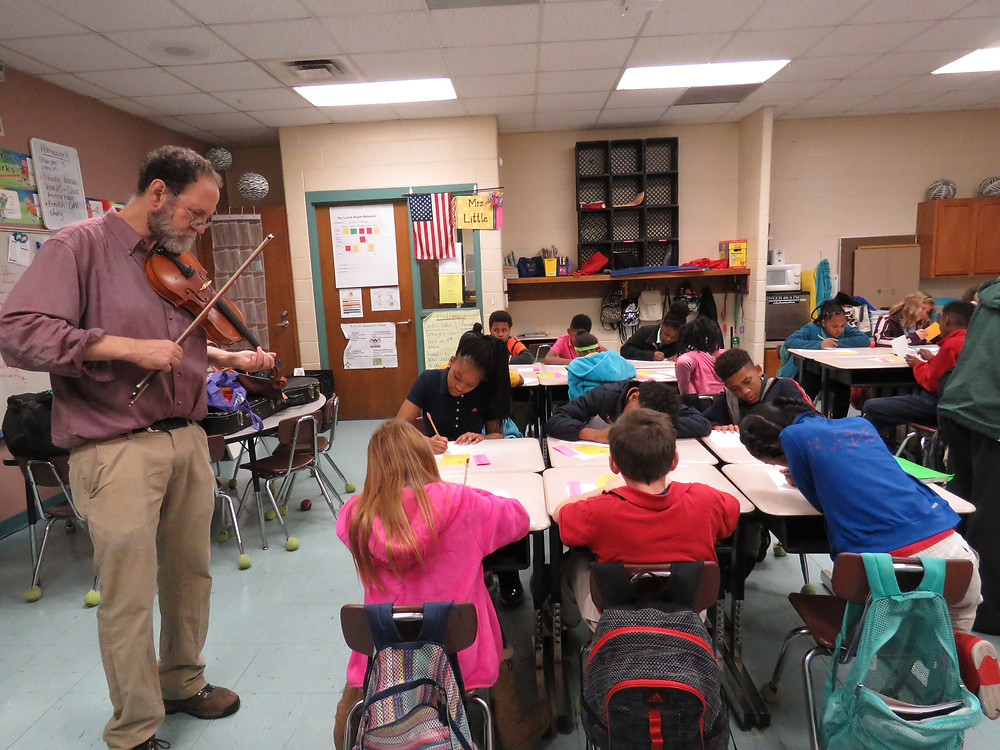 Ken Waldman playing a tune for students who are working on their first assignment with him in class.