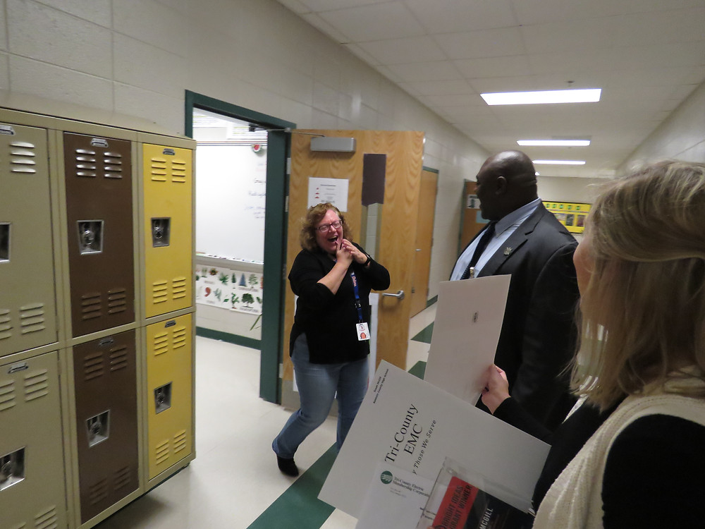 Susan McGill surprised by Dr. Cloise Williams and Tri-County EMC with her grant award.