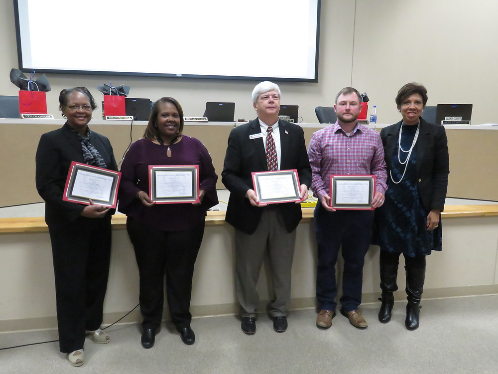 Board members receiving their recognitions.