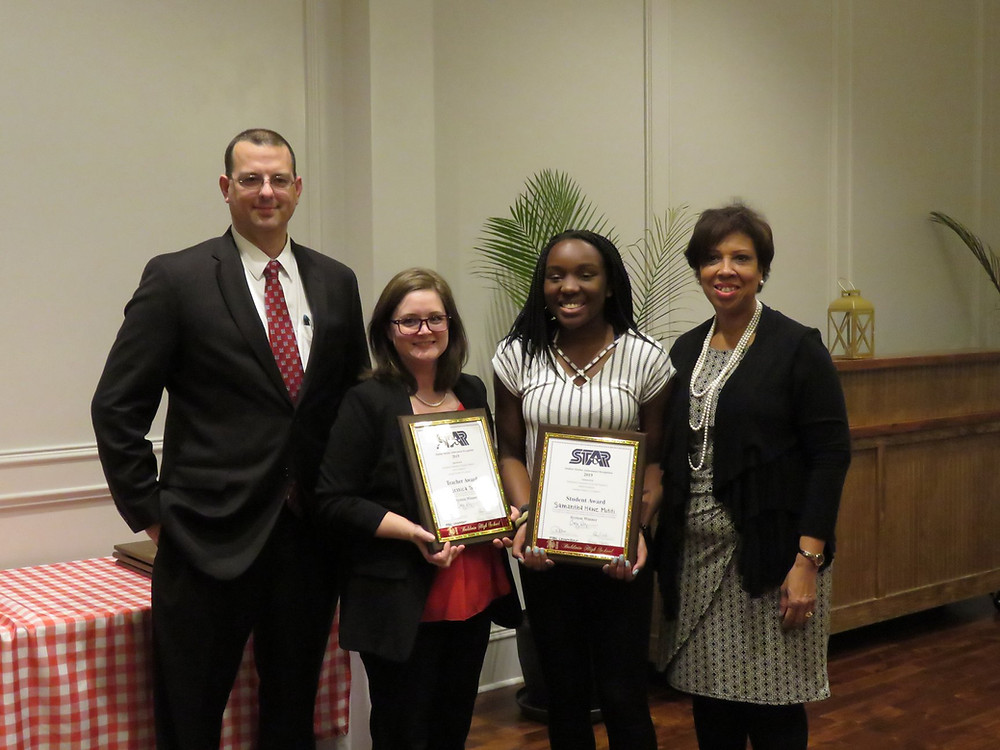 Samantha Mutiti and Jessica Thompson receiving their STAR Student and STAR Teacher awards.