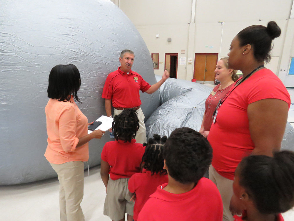 GYSTC organizers with students outside the StarLab