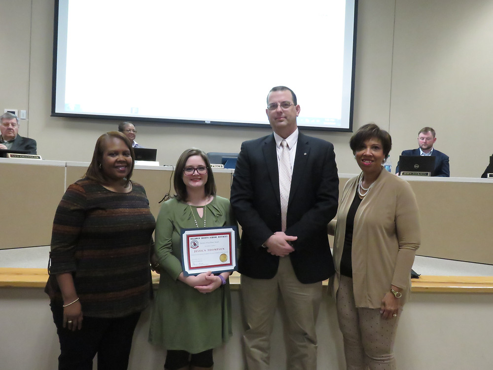 Ms. Thompson receiving her award.