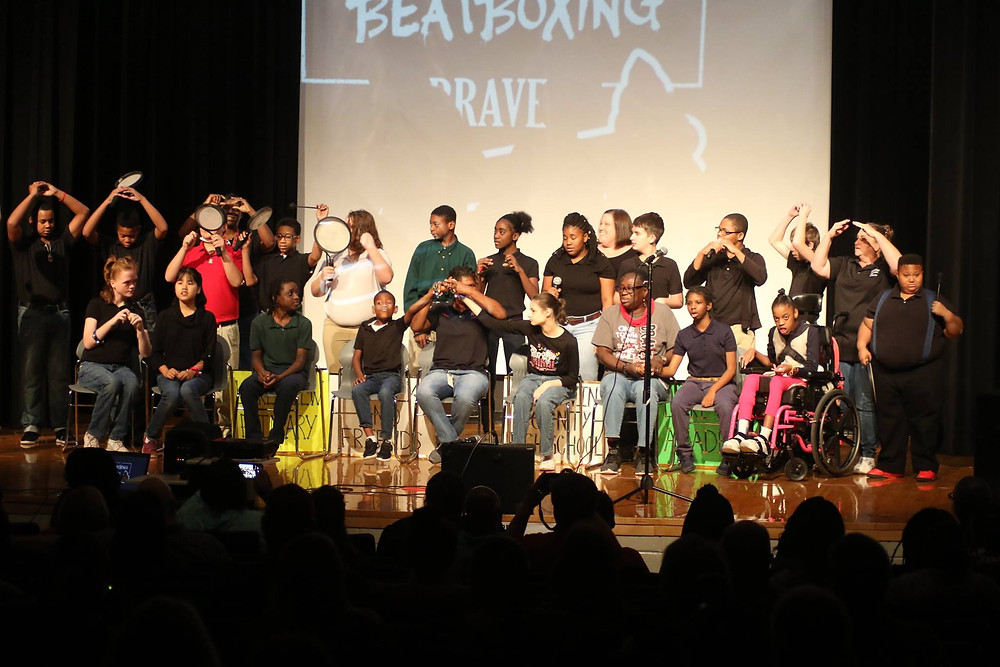 Students performing for music therapy.