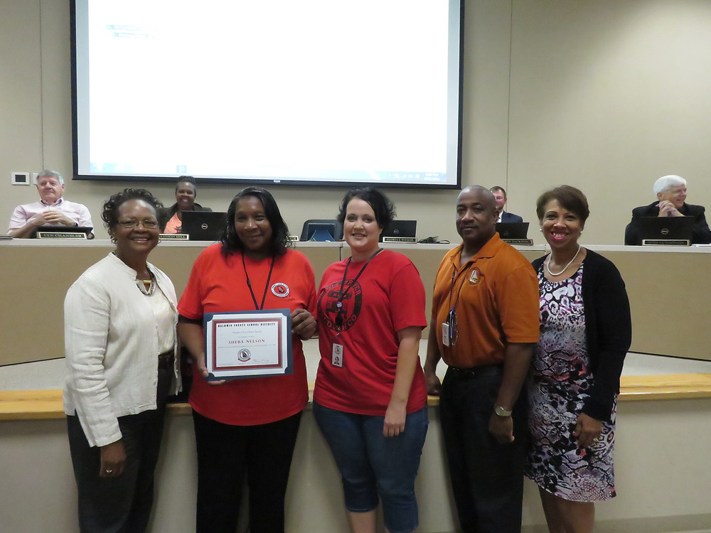 Sheeba Nelson receiving the boards recognition.