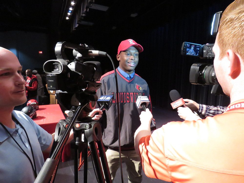 Jatavious Harris entertaining media interviews after his announcement.