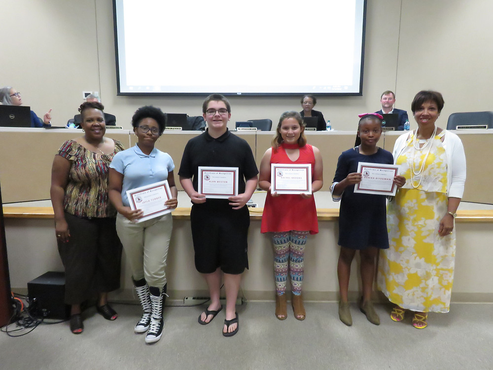 Students participating in the Duke TIP program being recognized by the board.