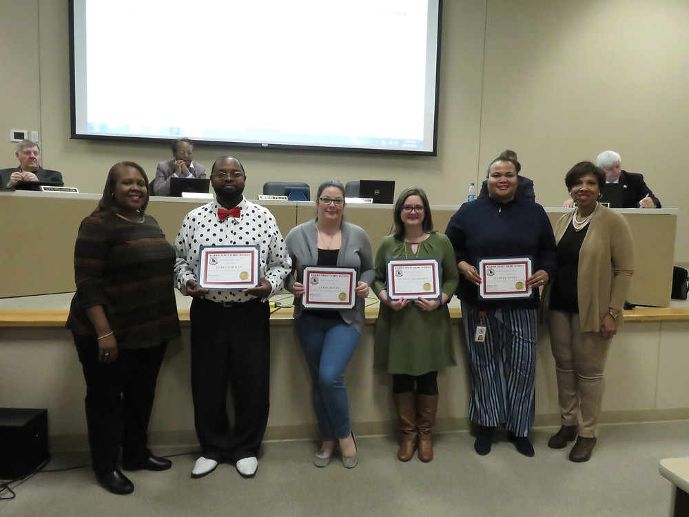 February's Pursuit of Excellence winners being recognized by the board.