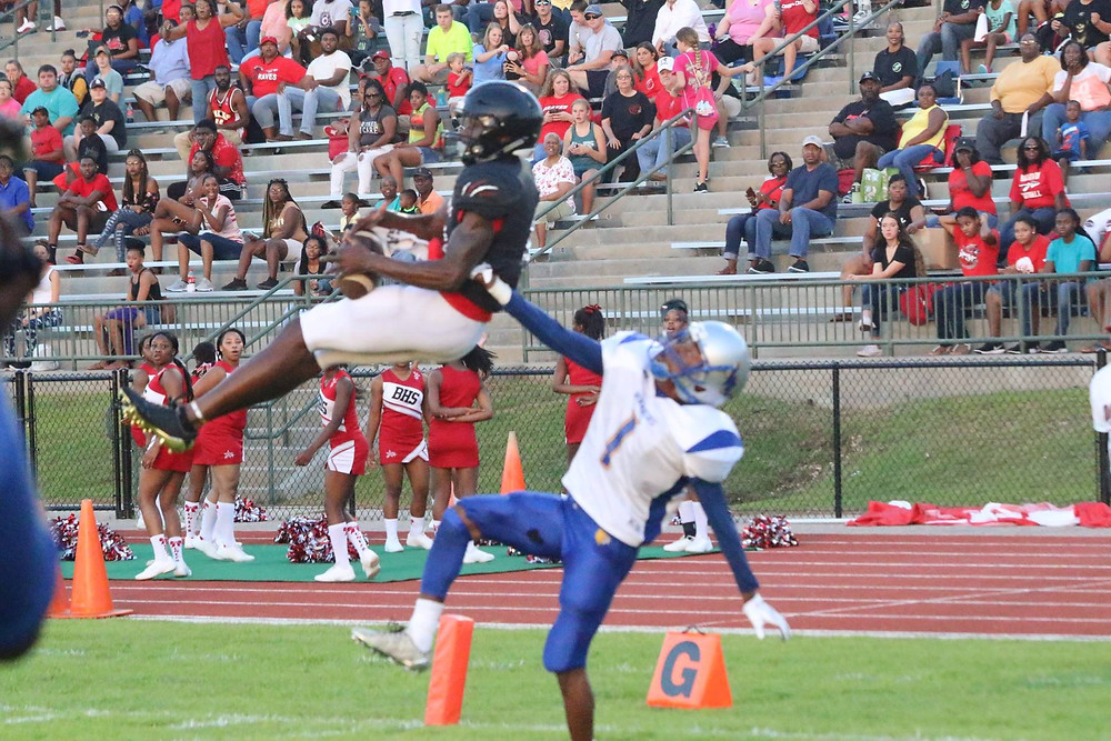 BHS wide receiver making a dramatic, leaping catch over a Wilkinson County defender for the first touchdown of the game.