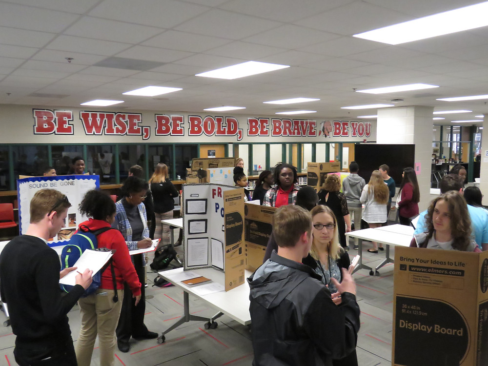 Baldwin High School Media Center with students presenting their science projects