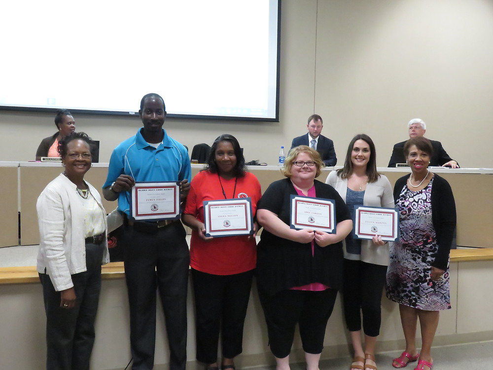 All pursuit of excellence winners being recognized by the board.
