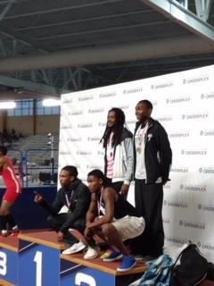 Braves 4x400 meter team on the podium.