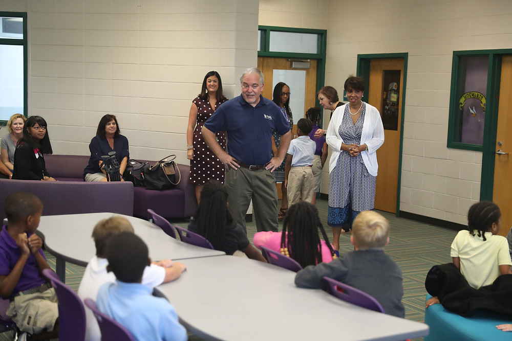 State Superintendent Richard Woods speaking with students at Lakeview Academy