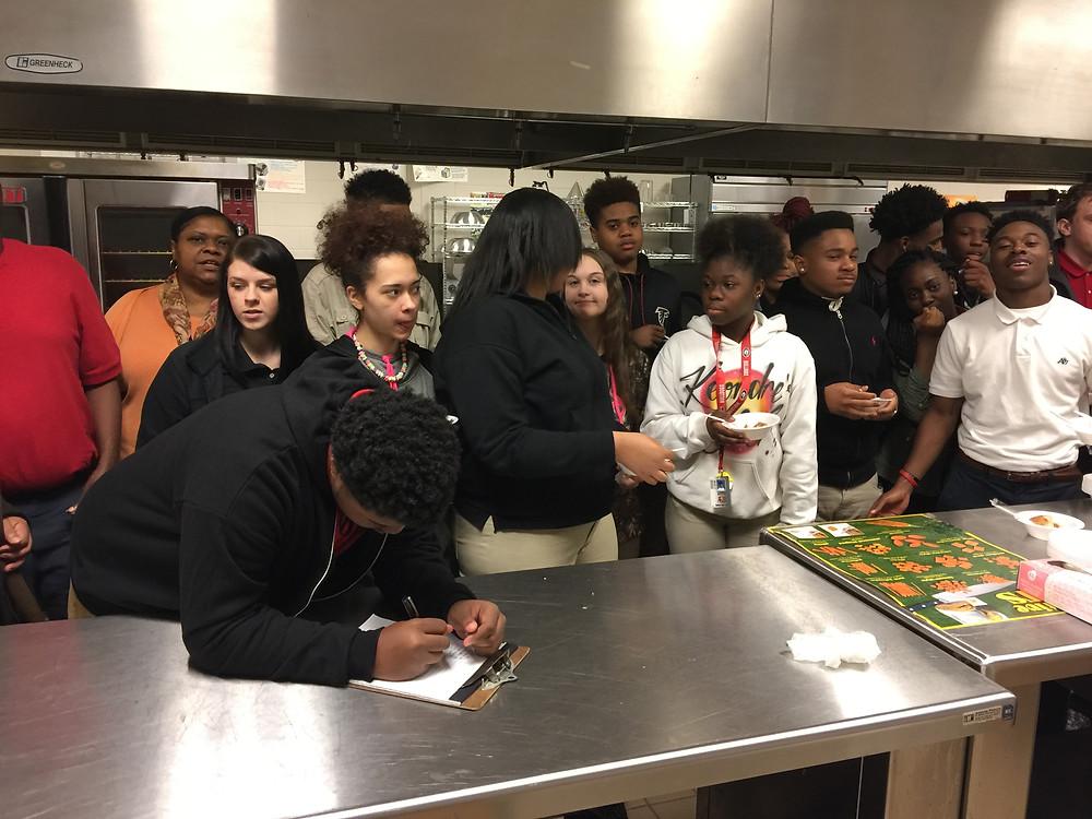 Students of Baldwin High School enjoying a taste test.