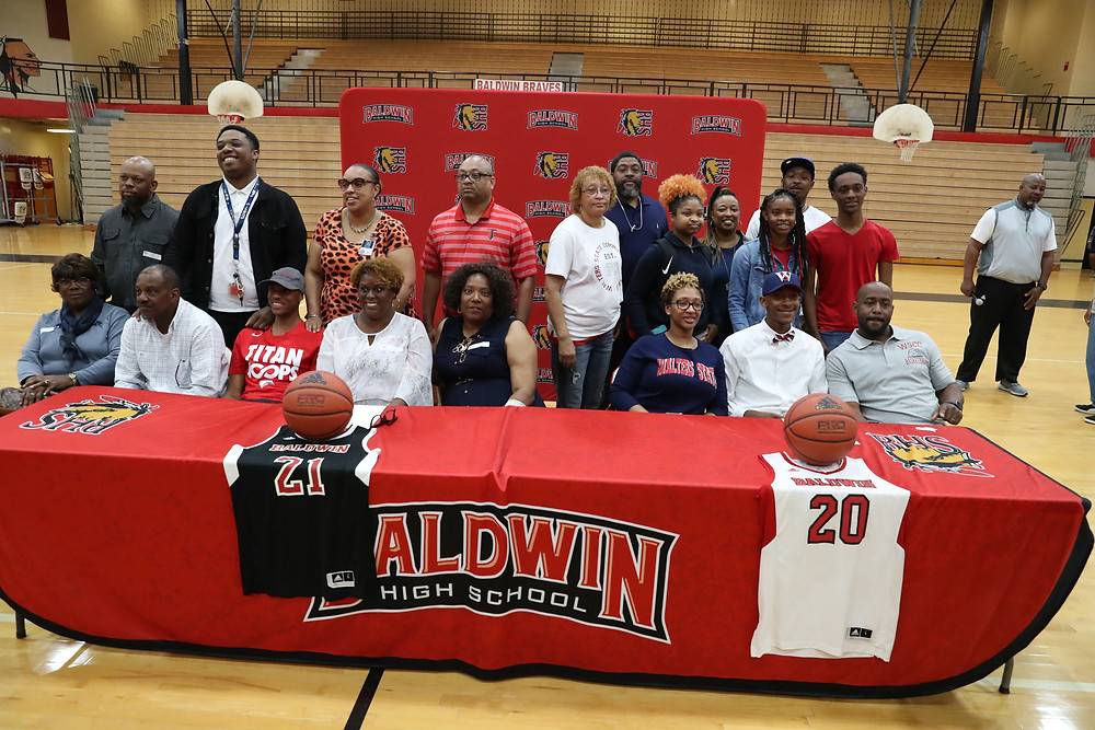 The players and their families celebrating after signing commitments.