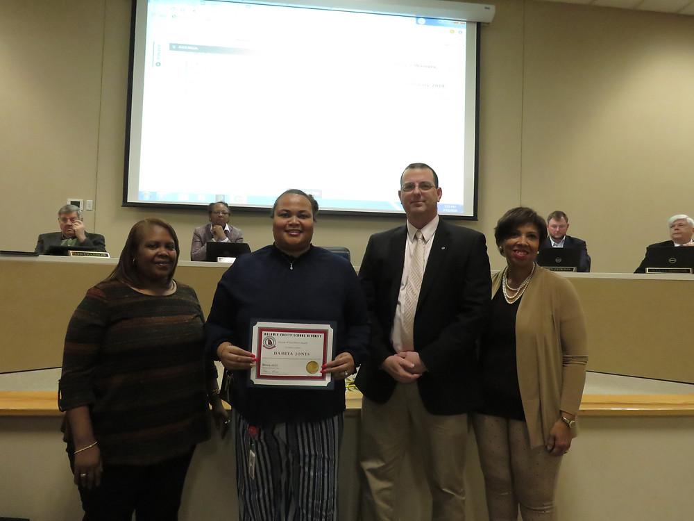 Ms. Jones receiving her award.