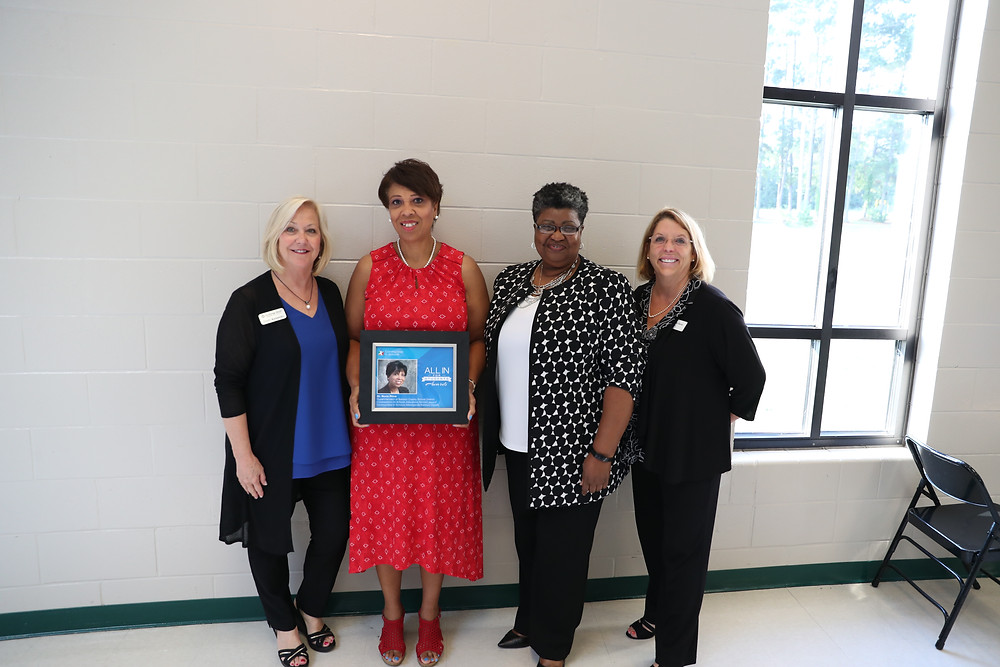 Dr. Price and representatives of Communities in Schools posing for a picture.