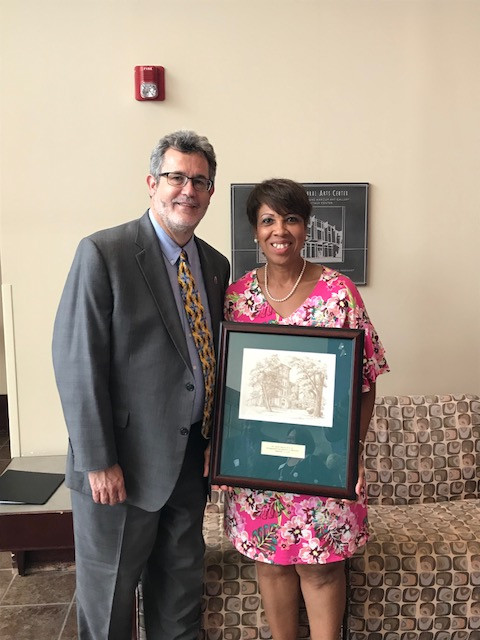 Dr. Price receiving her award.