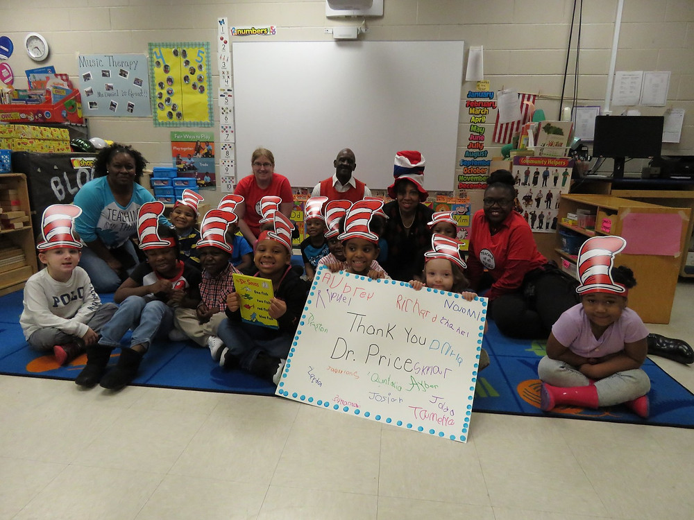 Dr. Price with students at the Early Learning Center