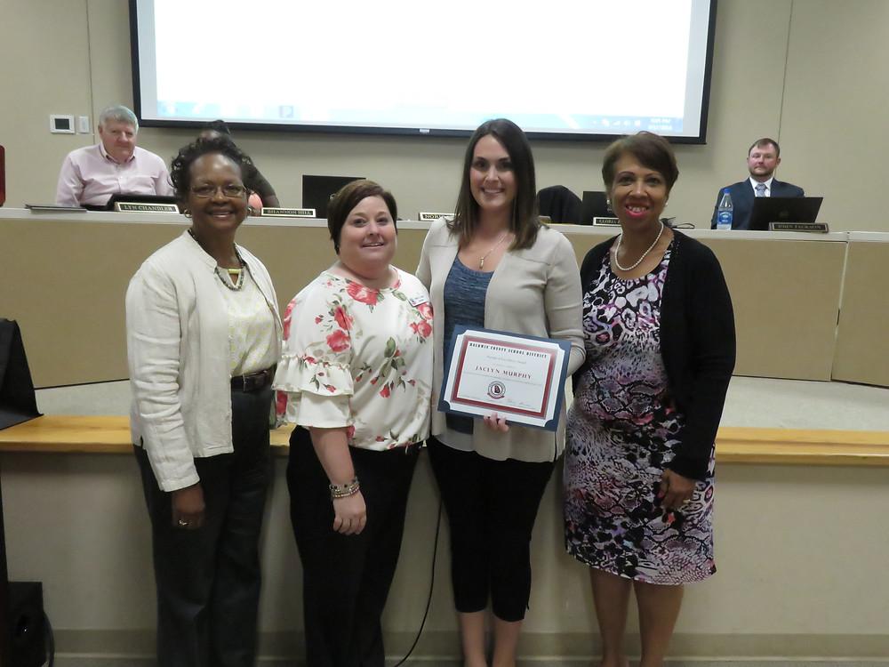 Jocelyn Murphy s receiving the boards recognition.
