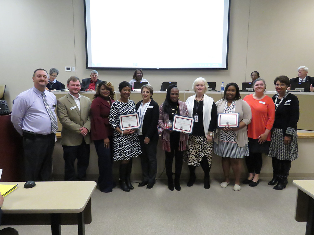 Pursuit of Excellence winners being recognized at this month's board meeting.