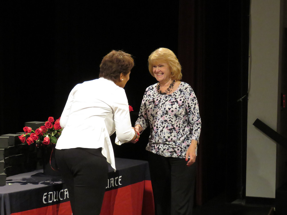 Retiree receiving her gift from Dr. Price