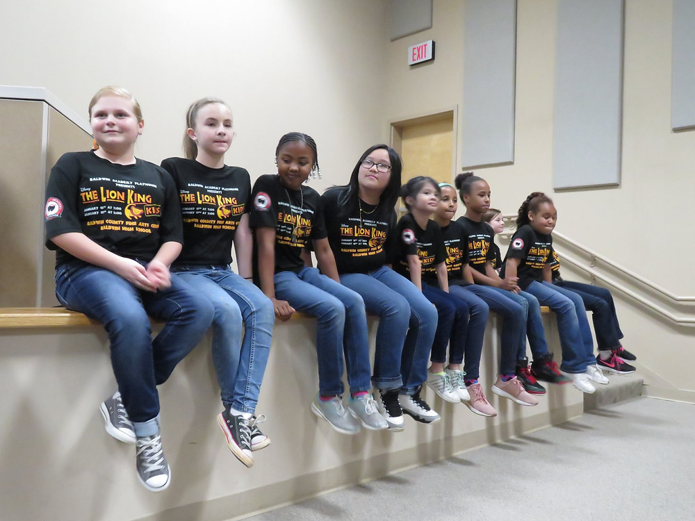 Students from the Baldwin Academy Playhouse previewing The Lion King
