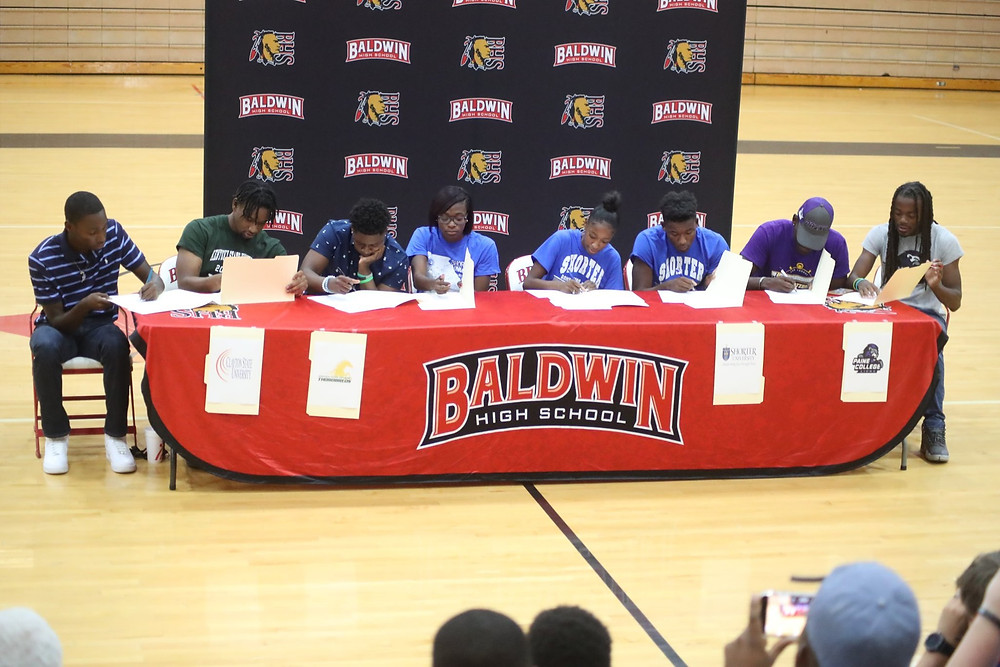 Student Athletes signing their letters of intent.