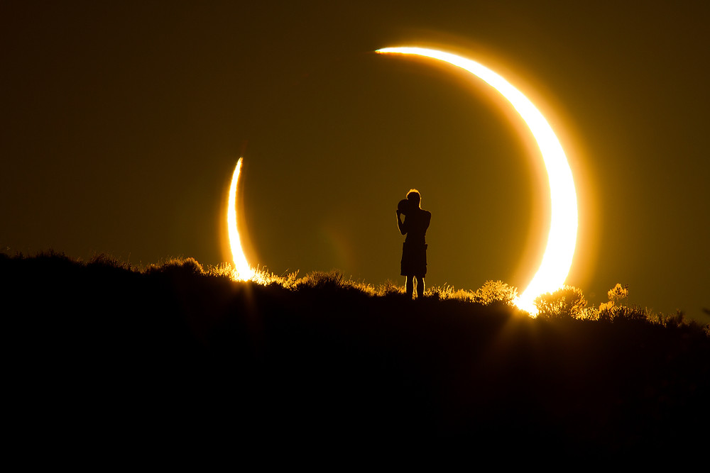 Photo of child watching solar eclipse